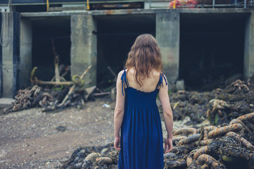 Young woman exploring shipyard