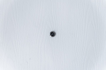 close up White Wood and  Door Peephole on White Door Texture