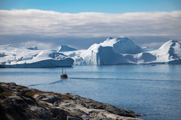 A boat and the icefjord in Ilulissat