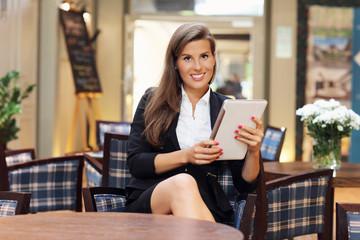 Young businesswoman working in restaurant