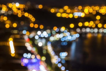 Blurred defocused lights of night city