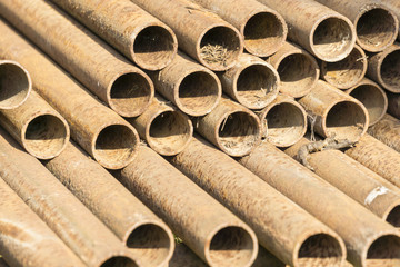 Stack of rusty steel pipes.