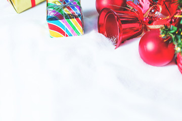 Christmas red balls and Gift box decorations on snow