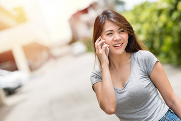 Happy beautiful young asian woman smile and talking on smartphone mobile.