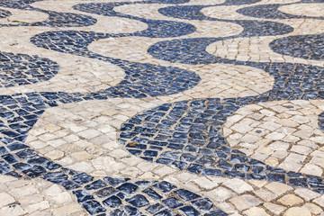 Patterned paving tiles in Lisbon city, Portugal