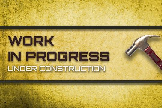 Work in progress under construction website yellow banner.