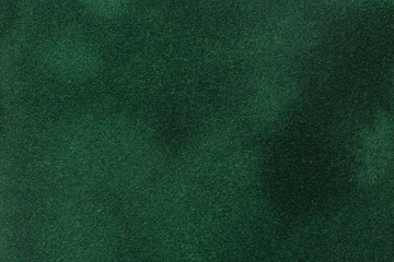 Dark green velvet paper for background.