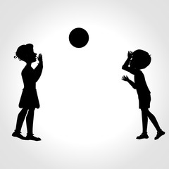 Children play with a ball silhouette