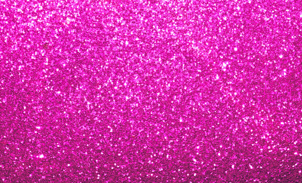 Vibrant colorful bright pink twinkle sparkle background.  Abstract textured backdrop