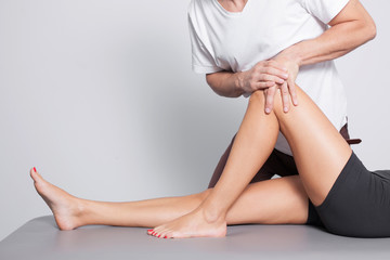 Professional leg massage in studio.