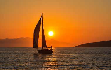 Sailing boat on the sea at sunset.