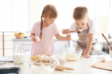 Kids making dough in kitchen