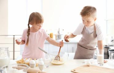 Kids making dough in kitchen