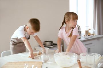 Kids making biscuits in kitchen