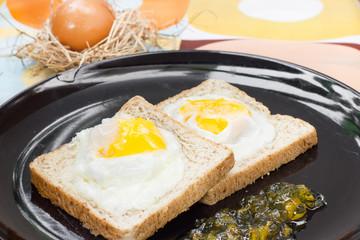 Egg bread and Orange jam breakfast.