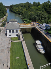 Pleasure boat in a lock on the Erie Canal, Lockport, New York State, USA