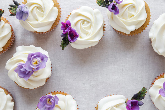rose almond cupcakes with purple edible flowers, , keto, ketogenic, low carb diet, sugar free, dairy free and  gluten free food