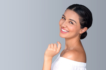 Beautiful natural fun vibrant hispanic woman smiling perfect skin teeth isolated space