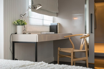 white table with wooden chair and books in modern working area