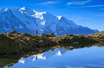 Man trail running at Lac De Chéserys, with the Mont Blanc in the background.