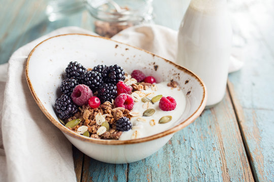 Delicious granola with blackberry, close-up