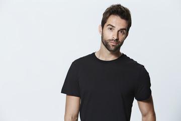 Black t-shirt guy in studio, portrait