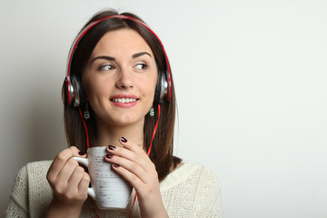 A young girl listens to music