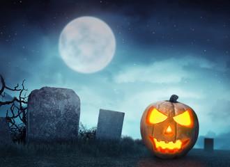 Spooky cemetery with glow halloween pumpkin