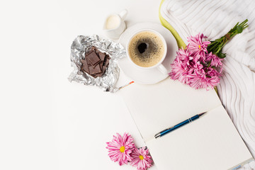 Cup of black coffee, Bouquet of pink flowers and Empty paper sheet, white table
