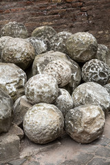 Ancient marble cannonballs in Castel Sant'Angelo in Rome, Italy