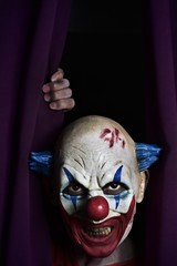 scary evil clown at the stage