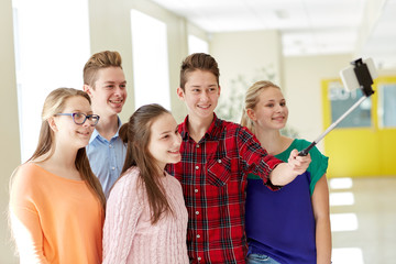 students taking selfie with smartphone at school