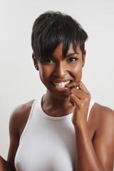 black woman bites her nail