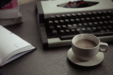 Vintage typewriter and coffee on stone board