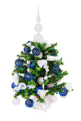 Christmas fir tree decorated with Christmas balls, snowflakes, candles, beads and pine branches isolated on white background.