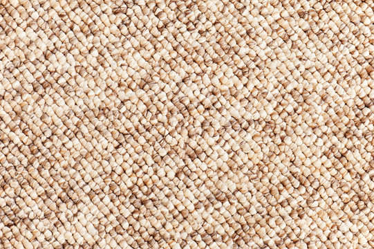 Beige - brown carpet texture for use as background. Closeup.