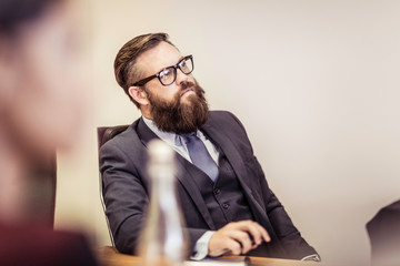 Businessman sitting at meeting