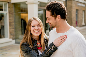 Portrait of happy young couple on Kings Road, London, UK