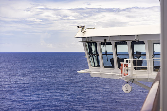Surveillance camera on a ship or ferry mounted on the bridge watching the decks below with an ocean background