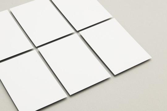 Blank white postcard flyer on a grey backgound