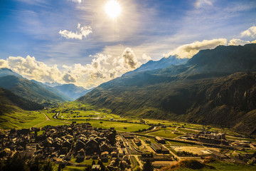 Idyllic summer landscape in the Alps with fresh green mountain