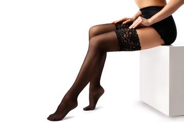 Beautiful female legs in black stockings