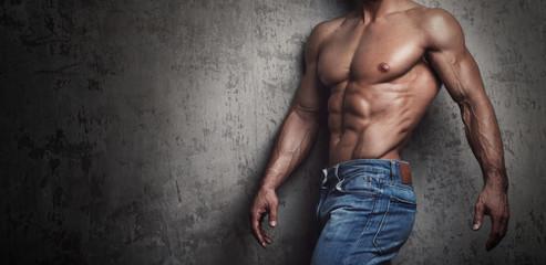 Muscular torso of man wearing jeans