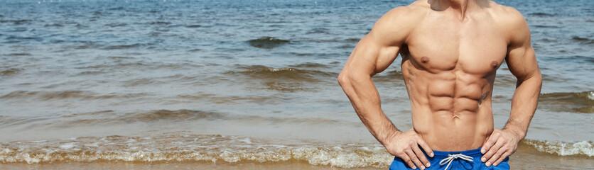 Muscular man on the beach