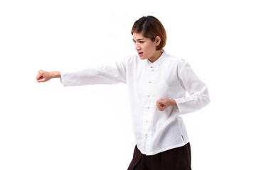 active, strong, confident asian woman punching, practice kungfu or tai chi quan, chinese martial arts concept