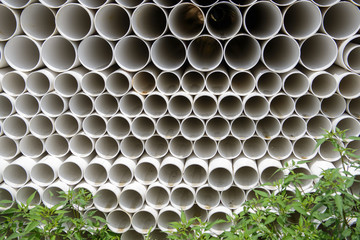 Close up of stack of plastic pipes