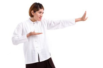 active, strong, confident asian woman practice kungfu or tai chi quan, baguazhang, chinese martial arts concept