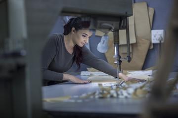 Female fashion designer working in factory