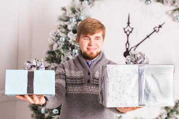christmas, x-mas, winter, happiness concept - smiling man with gift box