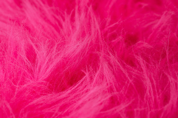 Pink plush fabric horizontal. Very soft polyester textile made of synthetic fibers with long hairs. Macro close up material photography.